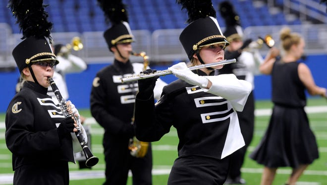Members of the Clyde High School Bulldog Band perform during the Class 3A Preliminary Rounds at the UIL State Marching Band Contest in San Antonio.