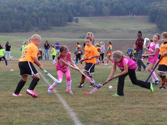 The third- and fourth-graders take to the field at the Whitney Point youth field hockey tournament on Sept. 12.