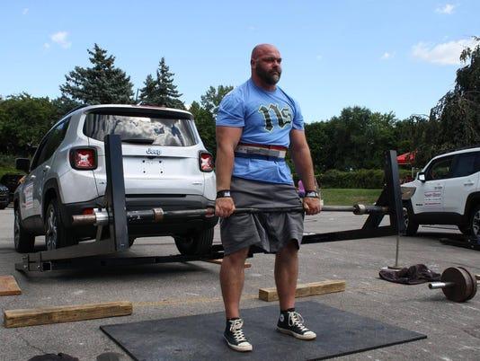 Battle Creek's Ben Yarger lifts car, tosses kegs