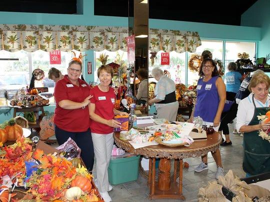 Retail manager Donna Vestal (on left) with volunteer/House
