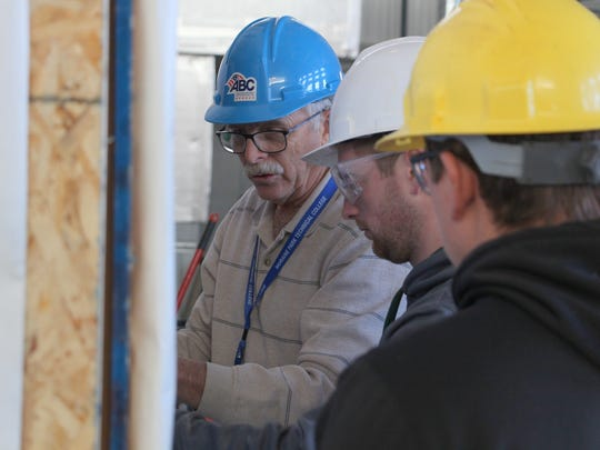 Gary Roehrig, Moraine Park Technical College's ABC Carpentry Apprentice Instructor, works with his students to create housing for homeless veterans.