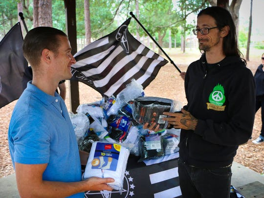 The Satanic Temple of West Florida donated 500 pairs of socks Sean's Outpost, a group that serves Pensacola's homeless population.