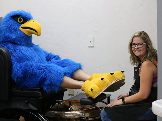 """Flash the Falcon stopped by Legacy Salon and Spa for a """"talon-icure"""" as a part of his mascot makeover."""