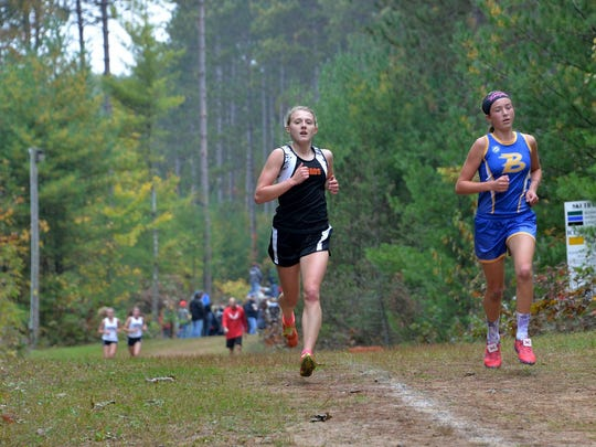 Iola-Scandinavia's Erika Kisting (left) will make her fourth appearance at state, taking part in the Division 3 girls race.