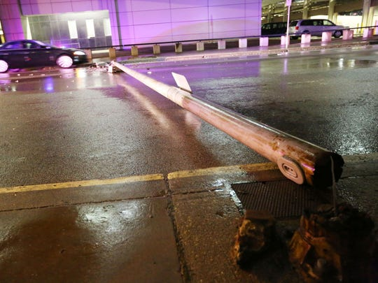 A light pole fallen in the street blocks several lanes of traffic on 3rd Avenue between Court Avenue and Walnut Street on Sunday night, Nov. 23, 2014.