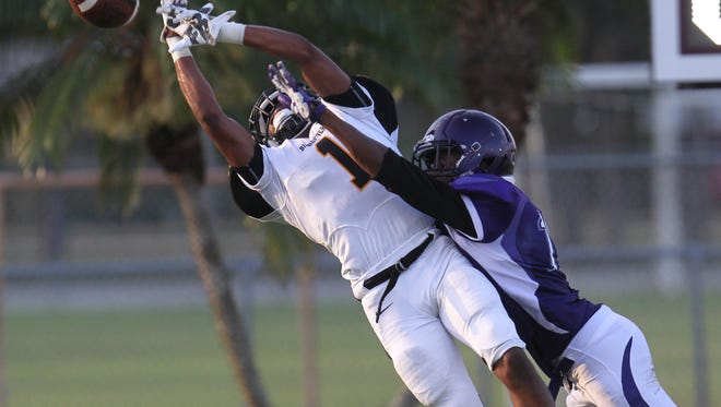 Cypress Lake competes with Bishop Verot during a spring football game at Cypress Lake High School on Wednesday.