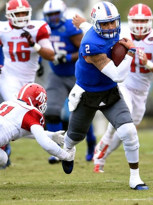 Tennessee State quarterback O'Shay Ackerman-Carter scrambles up the field past Austin Peay defensive back Demarion Allen (11) on Oct. 31, 2015..