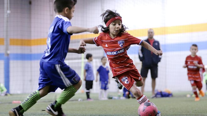 Ziggy Ramirez of FC Dallas dribbles up field at CR Sports in Canutillo at the indoor soccer facility as wind and rain hit outside Saturday.