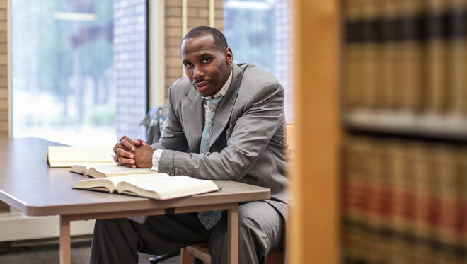 Activist Robert Davis is seen posing for a photo in the Wayne State University Law Library in Detroit on Thursday June 20, 2017.
