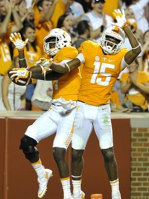 Tennessee's Preston Williams (7) celebrates his touchdown against Western Carolina with fellow wide receiver Jauan Jennings (15) at Neyland Stadium last season.