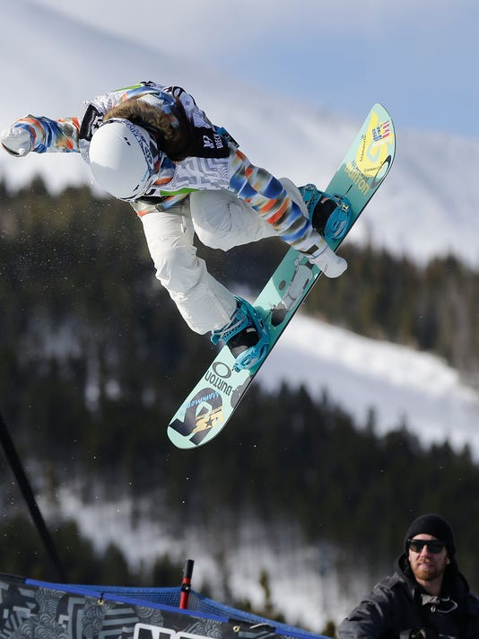 FILE - In this Dec. 14, 2013, file photo, Chloe Kim competes during the women's snowboarding superpipe final at the Dew Tour iON Mountain Championships in Breckenridge, Colo.   Kim's  parents are from South Korea, where the Olympic games will be held starting Feb. 9, 2018.  Among the handful of relatives who live there is Chloe's grandma, who has been known to brag about her high-flying granddaughter if, say, she's out to tea with her friends and a picture of Chloe happens to appear in the newspaper, which happens fairly often. (AP Photo/Julie Jacobson, File)