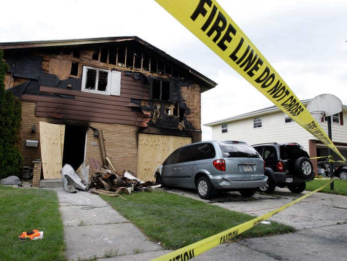 The  scene of the fire-damaged home at 1540 Ohio Ave. Monday July 14, 2014, 2014 in Sheboygan.