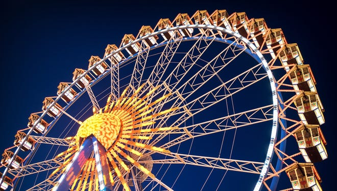 famous ferris wheel at the oktoberfest in munich - germany