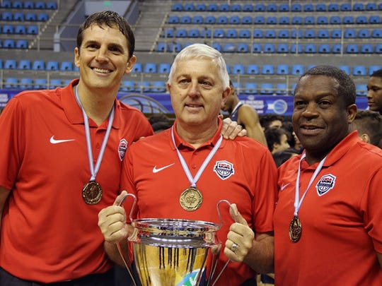 Sanford's Stan Waterman (right) celebrates with USA Basketball head coach Don Showalter (center) and assistant Scott Fitch of Fairport, N.Y., after winning the U16 FIBA Americas basketball tournament in Formosa, Argentina.