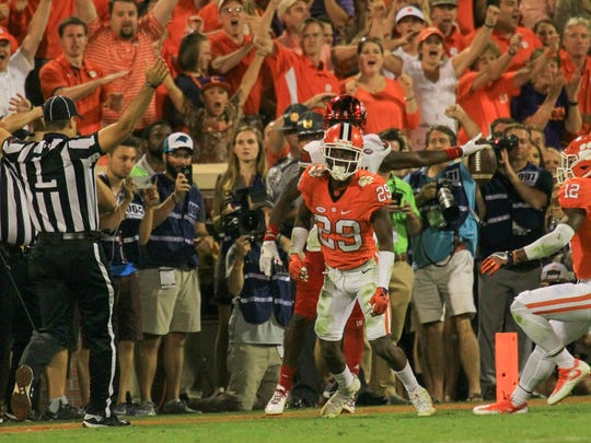 Clemson cornerback Marcus Edmond (29) celebrates stopping Louisville wide receiver James Quick (17) one yard short of converting 4th-and-12 on the Cardinals' final offensive play of Clemson's 42-36 win on Oct. 1 at Memorial Stadium.