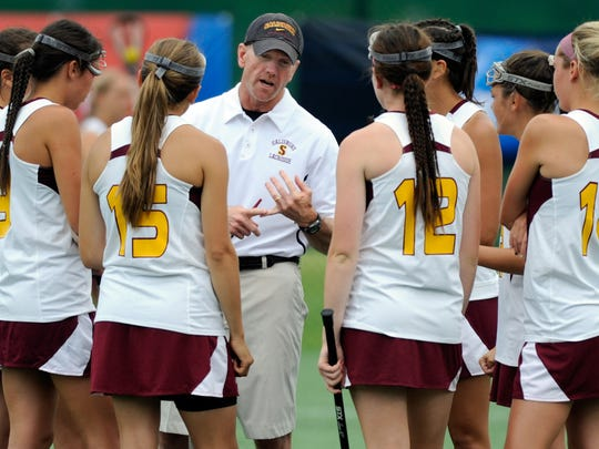 Salisbury women's lacrosse head coach Jim Nestor talks to a group of his players during halftime of a Division III national semifinal Saturday, May 18, 2013 at Stevenson University in Owings Mills. Salisbury beat Middlebury 8-7. (Photo by Steve Ruark)