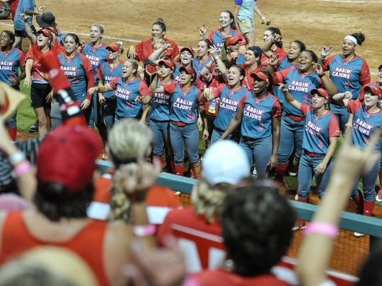 Louisiana Softball cheer on their fans after beating