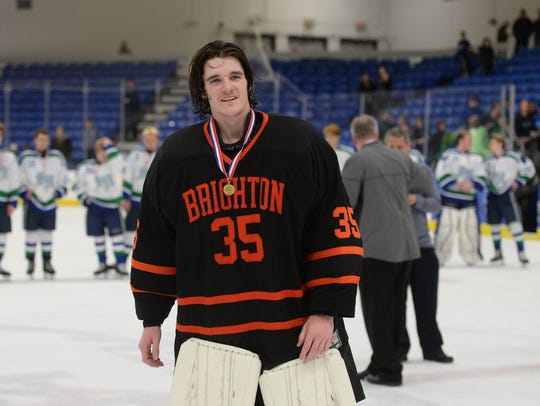 Brighton goalie Harrison Fleming is all smiles with