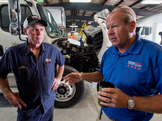 Shop foreman Skipper Davis, left, and Service manager Tony Snead discuss the work at Four Star Frieghtliner in Montgomery, Ala. on Wednesday May 23, 2018.