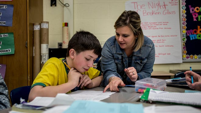 Kristie Cramton works with Elijah Hurt, 13, during an algebra class Thursday, Jan. 19, 2017 at Yale Jr. High School. Cramton has been nominated for the national LifeChanger of the Year Award.