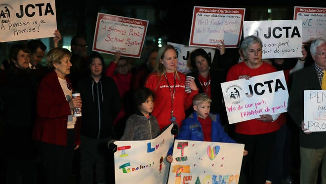 Teachers, current and former, parents and kids attended a rally outside of Atherton High School Monday morning. The 'walk in' was a call to the state for more public education funding, as well as retirement security and quality affordable health care for all education employees.