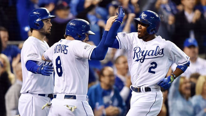 Alcides Escobar celebrates with teammates after scoring a run in the second inning.