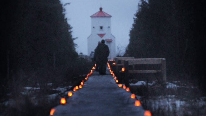 The boardwalk to the lower range light at The Ridges is lighted with luminaries during the Natural Christmas event.