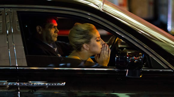 Gaga sits in her car following her protest at Trump