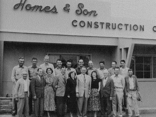 "This picture, taken in the early 1950s, shows Homes & Son founder I. G. ""Pete"" Homes (bottom row, sixth from left) with family and staff outside the 1420 E. Bethany Home Road office. The company remained in that location from about 1950 to 1970."