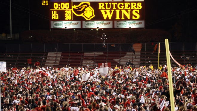 Rutgers fans storm the field after the Scarlet Knights upset third ranked Louisville 28-25, Thursday, November 9, 2006, at Rutgers Stadium in Piscataway.