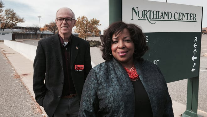 From left, Southfield mayoral candidates Ken Siver and Sylvia Jordan stand beside a sign at vacant Northland Center, which  will be a city challenge to redevelop for the winner of the race.