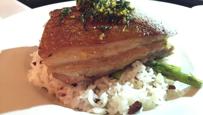 The slow braised 5 spiced pork belly, served with a citrus gremolata and garlic rice pilaf, at the Rotten Apple Steampunk Restaurant.