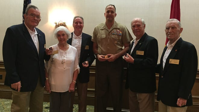 From left, Jim Sullivan, Marilyn Paige, Vince Mast, Major Gen. Daniel J. O'Donohue, commanding general of the 1st Marine Division, George Stettler and World War II veteran Les Carlyle at the Desert Cities Mitchell Paige Medal of Honor Chapter 1st Marine Division Association luncheon on April 21, 2016 at the Classic Club in Palm Desert.
