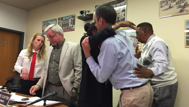 Asbury Park City Council members give hugs to Joe Woerner, who announced he would step down to care for his sick son.