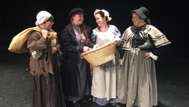 The Selling of Scrooge's belongings. From left: Charwoman, played by Myra Glasford; Joe, played by Kayla Harris; Laundress, played by Riley Courter and Undertaker, played by Bailey Hanson.