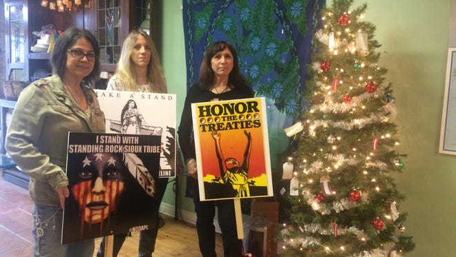 Standing Rock protesters soon will get a helping hand from Howell, thanks to these three residents, from left, Kokopelli's Korner owner Cathy Boaz, Highland resident Michelle Carrier and Howell resident Pat Stachowiak.