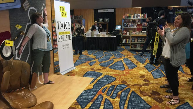 "True crime fans take an ""incriminating selfie"" during CrimeCon at the J.W. Marriott, Jun 9-11."