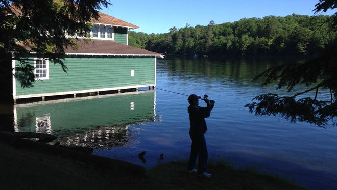 An angler makes a cast into Tomahawk Lake near Woodruff, Wis.
