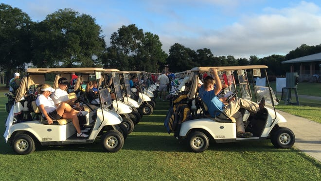 Golfers line up for a previous Panhandle Charitable Open. This year's event will be Sept. 28-30.