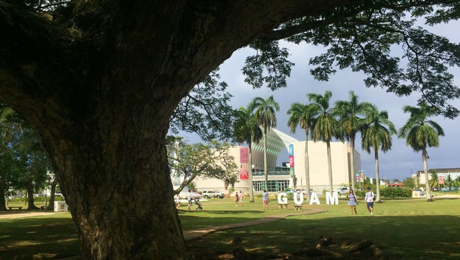 Tourists flock to the Guam sign in the Plaza de España in Hagåtña in this file photo.
