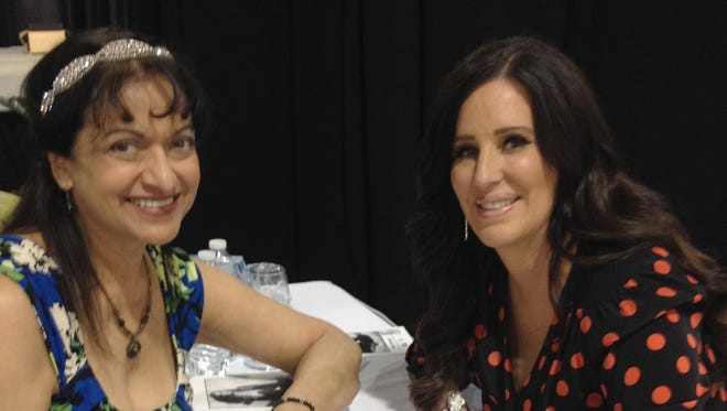 Theresa Sitto, the owner of MATCHaldean, a company to help singles meet and get married is on the left. On the right is Patti Stanger, the star of the reality TV series The Millionaire Matchmaker, at the Suburban Collection Showplace on May 2, 2014.