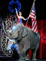 "FILE - In this May 1, 2016, file photo, an Asian elephant performs during the national anthem for the final time in the Ringling Bros. and Barnum & Bailey Circus in Providence, R.I. The Ringling Bros. and Barnum & Bailey Circus ended ""The Greatest Show on Earth"" on May 21, 2017, following a 146-year run. Declining attendance combined with high operating costs, along with changing public tastes and prolonged battles with animal rights groups all contributed to its demise. (AP Photo/Bill Sikes, File)"