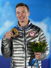 Reno's David Wise poses after receiving his gold medal during the medal ceremony for ski halfpipe in Sochi in 2014.