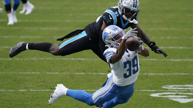 Carolina Panthers strong safety Juston Burris breaks up a pass intended for Detroit Lions wide receiver Jamal Agnew during the second half of an NFL football game Sunday, Nov. 22, 2020, in Charlotte, N.C.