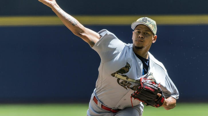 St. Louis Cardinals' Carlos Martinez pitches to a Milwaukee Brewers batter during the first inning of a baseball game Monday in Milwaukee.
