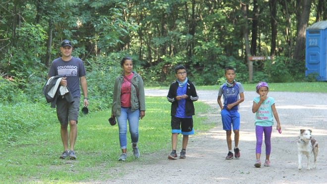 B.J. and Jennifer Rider of Sturgis, with their children Logan, Tyler, Olivia, and Lucy the family dog, checked out the trails  on Saturday at Camp Fort Hill