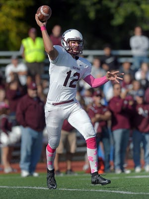 Aquinas quarterback Jake Zembiec throws a pass rolling out of the pocket during a regular season game played at McQuaid Jesuit.