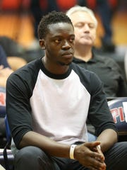 Detroit Pistons guard Reggie Jackson listens as Avery