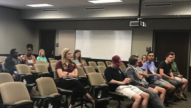 Students begin to arrive for a candidate forum last Thursday at the Dunlap Student Success Center.