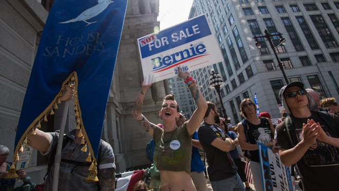 A supporter of former Democratic presidential candidate Bernie Sanders cheers at a rally at City Hall in Philadelphia on Monday.